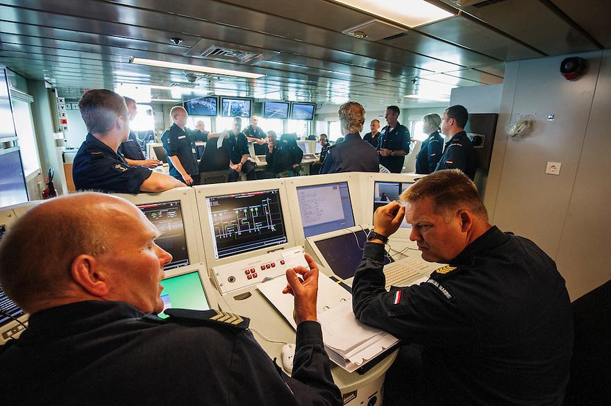 Nederland, Den Helder, 4 sept 2013<br /> Debriefing van de manschappen op patrouilleboot van de Marine de ZM Friesland na een oefening.<br /> Marine moet ook fors bezuinigen.<br /> <br /> Foto(c): Michiel Wijnbergh