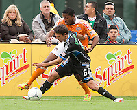 San Francisco, California - Saturday March 17, 2012: Jermaine Taylor and Shea Salinas fights for the ball during the MLS match at AT&T Park. Houston Dynamo defeated San Jose Earthquakes  1-0