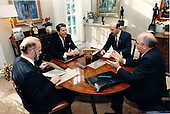 United States President Ronald Reagan and General Secretary of the Communist Party of the Soviet Union Mikhail Sergeyevich Gorbachev meet in the Oval Office study during the morning of Wednesday, December 9, 1987.  The U.S. and U.S.S.R. interpreters attended the meeting..Mandatory Credit: Bill Fitz-Patrick - White House via CNP