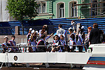 Europe, Russia, St. Petersburg. Russian hospitality group on a canal cruise.