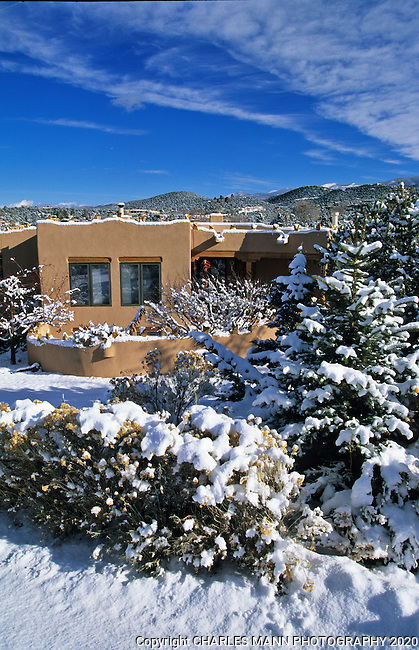 A fresh coating of snow covers adobe houses in the foothills abouve Santa Fe, New Mexico