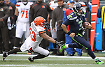 Seattle Seahawks quarterback Russell Wilson (3) scrambles for a first down against Cleveland Browns linebacker Craig Robertson (53) at CenturyLink Field in Seattle, Washington on December 20, 2015. The Seahawks clinched their fourth straight playoff berth in four seasons by beating the Browns 30-13.  ©2015. Jim Bryant Photo. All Rights Reserved.