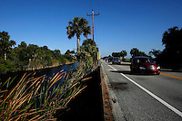 Everglades, Fla. -- Feb. 18, 2007 -- Motorists make their way along the scenic Tamiami Trail, where alligators and picturesque landscapes can be seen without slowing, near Big Cypress Bend just north of Everglades National Park on the southern tip of Florida on Sunday, Feb. 18, 2007. (Chip Litherland for The New York Times)