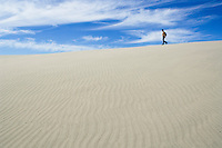 Walking among sand dunes at Farewell Spit, New Zealand