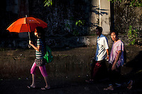 People walk through central Yangon.