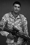 Lcpl. Edgar Aguilera, 20, Los Angeles, California, Weapons Platoon, Kilo Co., 3rd Battalion 1st Marines, United States Marine Corps, at the company's firm base in Haditha, Iraq on Sunday Oct. 22, 2005.
