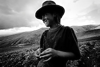 Andahualas, Peru, February, 2, 2007 - While on summer break from school, Saida Basques, spends her time working the potato fields high in the mountains above Andahuaylas, along with the rest of her family. Her brothers and father work the fields, her mother cooks breakfast and lunch for the crew, and she carries water to the hands. She says she enjoys being there because she loves being close to her family.