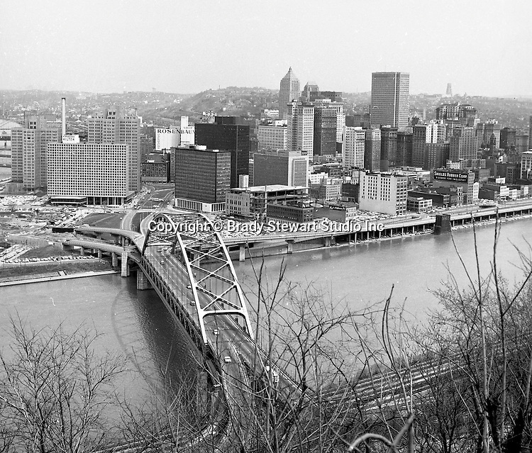 Pittsburgh PA:  View of the Pittsburgh skyline and new Fort Pitt Bridge from Mt Washington - 1962.  View includes exit ramps from Fort Pitt Bridge under construction along with the Pittsburgh Press building.