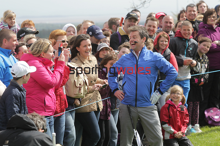 Ant & Dec showing off their golf skills during the Celebrity Golf @ Golf Live.Dec posing for the golf fans...Celtic Manor Resort.11.05.13.©Steve Pope
