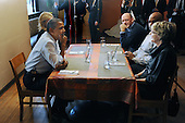 United States President Barack Obama (front L) has lunch with winners of a campaign contest, at Scion Restaurant in Washington DC, USA, on 06 January 2012..Credit: Michael Reynolds / Pool via CNP