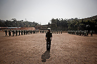KIA female officer leads military basic training for new recruits at one of the trainig camps outskirsts Laiza city, the headquarters of the Kachin Independence rebel Army. Since the begining of the Kachin uprising for its sovereignty women always fought by side the rebel soldiers, but officially, the female KIA was founded in 2007, since then, up to 1500 women have joint to the rebel army. The KIA is enhancing its troops number since the ceasefire was broken out by the Burmese army last June 2011.