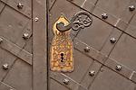 A door lock in Krakow, Poland. An ornate black and gold door lock