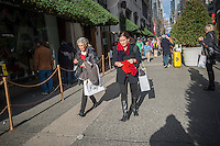 Shoppers on Fifth Avenue outside of Lord & Taylor in New York looking for bargains on Black Friday, the day after Thanksgiving, Friday, November 29, 2013. Many retailers, including Macy's, opened their doors on Thanksgiving or opened up for Black Friday the night before extending the shopping day into over 24 hours. (© Richard B. Levine)