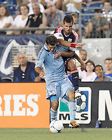 Sporting Kansas City midfielder Graham Zusi (8) intercepts New England Revolution forward Benny Feilhaber (22) dribble. In a Major League Soccer (MLS) match, Sporting Kansas City defeated the New England Revolution, 1-0, at Gillette Stadium on August 4, 2012.