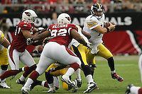10/23/11 Glendale, AZ: Pittsburgh Steelers quarterback Ben Roethlisberger #7 and Arizona Cardinals nose tackle Dan Williams #92 during an NFL game played at University of Phoenix Stadium between the Arizona Cardinals and the Pittsburgh Steelers. The Steelers defeated the Cardinals 32-20.
