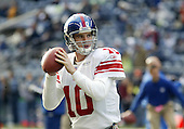 27 Nov 2005:   New York Giants quarterback Eli Manning warmed up before the start of the game against the Seattle Seahawks at Qwest Field in Seattle, Washington.