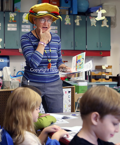 WATERTOWN CT. 26 October 2015-102615SV06-Kindergarten teacher Mary Anne Cutrali wears a hamburger hat while teaching the letter H to her class at John Trumbull Primary School in Watertown Monday. Watertown's Director of Curriculum is proposing a full day kindergarten program for next year.<br /> Steven Valenti Republican-American
