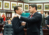 TALLAHASSEE, FLA. 5/3/13-SESSIONEND050313CH-House budget chair Rep. Seth McKeel, R-Lakeland, left, is congratulated by Rep. Steve Crisafulli, R-Merritt Island, on the final day of the legislative session May 3, 2013 at the Capitol in Tallahassee...COLIN HACKLEY PHOTO