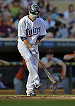 29 September 2012: Minnesota Twins infielder Jamey Carroll knocks dirt from his cleats during a game against the Detroit Tigers at Target Field in Minneapolis, MN. The Tigers defeated the Twins 6-4 in the second game of their 3-game series. Mandatory Credit: Ed Wolfstein Photo