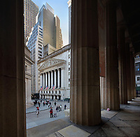 New York Stock Exchange, designed by George B Post in Neoclassical style, and built in 1903, at 11 Wall St, Lower Manhattan, New York, New York, USA, seen from between the columns of Federal Hall National Memorial. The facade of the NYSE features 2 square corner pillars and 6 columns with Corinthian capitals. The pediment features a sculptural scene by John Quincy Adams Ward entitled Integrity Protecting the Works of Man. Picture by Manuel Cohen