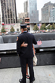 On the 10th anniversary of the September 11th attacks, pausing to remember fallen comrades at the South Memorial Pool at opening day of the September 11th Memorial at the World Trade Center site in New York, New York on Sunday, September 11, 2011..Credit: Jefferson Siegel / Pool via CNP