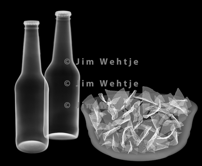 X-ray image of beer and chips (white on black) by Jim Wehtje, specialist in x-ray art and design images.