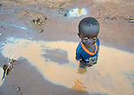 A child in the Ajuong Thok Refugee Camp in South Sudan. The camp, in northern Unity State, hosts thousands of refugees from the Nuba Mountains, located across the nearby border with Sudan.