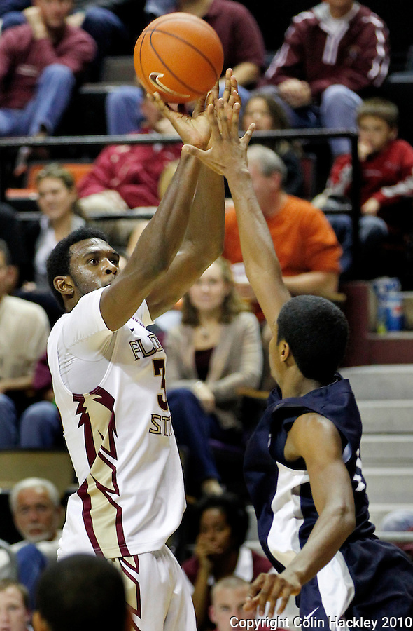 TALLAHASSEE, FL 11/12/10-FSU-ASU MBB 111210 CH-Florida State's Chris Singleton shoots over North Florida's Brian Holmes during second half action Friday at the Donald L. Tucker Center in Tallahassee. The Seminoles beat the Ospreys 75-55..COLIN HACKLEY PHOTO
