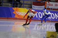 SPEED SKATING: CALGARY: Olympic Oval, 08-03-2015, ISU World Championships Allround, Danni Morrison (CAN), Denis Yuskov (RUS), ©foto Martin de Jong