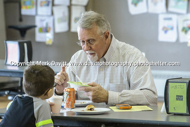 Darrel Jensen  and his grandson Miles Curtis enjoy a snack at the fourth annual 4th Altoona Elementary Golf in the Halls was held Jan. 28. Participants enjoyed a breakfast and  two, 18-hole mini-golf courses throughout the school's classrooms, hallways and gymnasiums.