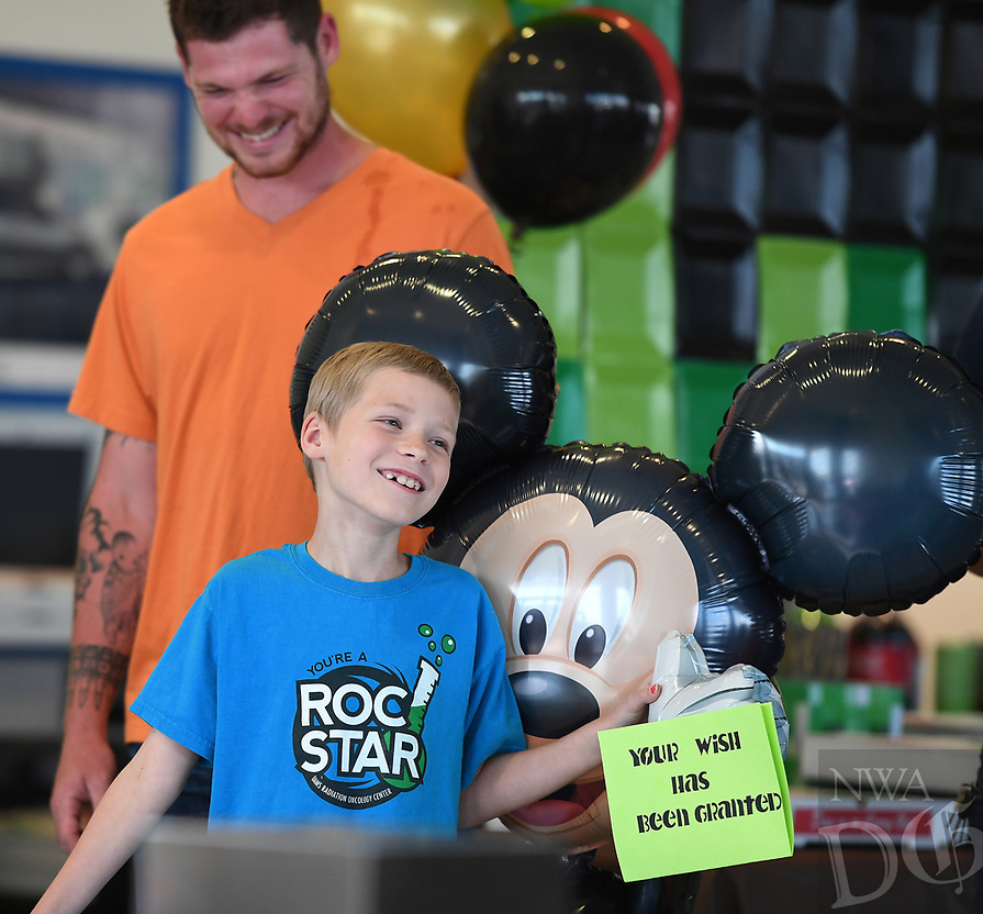 NWA Democrat-Gazette/J.T. WAMPLER Nate Croasdell, 7,  smiles with his dad Nick Croasdell of Gravette Wednesday May 17, 2017 after learning his wish to go to Disney World has been granted. Nate has neuroblastoma, a type of cancer commonly found in the adrenal glands. Honda of Fayetteville hosted the reveal party and sponsored the trip along with Make-A-Wish Mid-South.