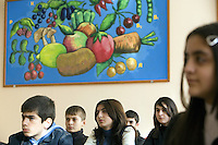 Azerbaijan. Ganja Region. Ganja. Secondary school no:6. Classroom. Life Skills Based Education (LSBE). 7th Class. The pupils listen to a lesson on HIV Aids awaraness. A painting on the wall with various fruits and vegetables, like apple, lemon, carrot, potatoe, tomato, green pepper, cherry, plums,...The Global Fund through the Ministry of Health supports the harm reduction program with an Aids grant (financial aid). © 2007 Didier Ruef