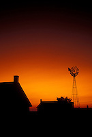 AJ3031, amish, silhouette, Amish country, Lancaster County, Pennsylvania, Pennsylvania Dutch Country, A silhouette of an Amish farm and steel wind mill at sunset in Lancaster in the state of Pennsylvania.