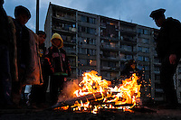 Children warm up by a fire on the street in the Gipsy ghetto of Chanov on outskirts of Most, Czech Republic, 19 December 2008.