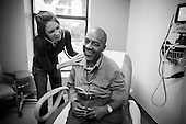 """Physician assistant Jen Vaupel examines Robert """"Bobby"""" Young's during a check up at Bread for the City in Washington, DC."""