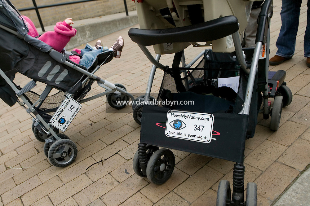 22 November 2006 - New York City, NY - View of strollers carrying Howsmynanny.com number plates in a park in New York City, USA, 22 November 2006. The plate allows people to report any good or bad behaviour by the nanny to the website which then relays it to the parents.