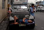 Filipino workers take a break in Manila, Philippines..**For more information contact Kevin German at kevin@kevingerman.com