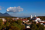 Elevated view of the town of Juayua and its church.  Juayua is a main attraction on the Route of Flowers in western El Salvador.  The Izalco Volcano is seen in the background.