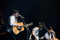 "Marcus Mumford, Winston Marshall, and Ted Dwane perform the hit ""Little Lion Man,"" from Mumford & Sons' debut album Sigh No More at the Susquehanna Bank Center on February 16, 2013."