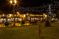 Peru, Cusco.  Plaza de Armas at Night.  Lights show new neighborhoods advancing up the hills surrounding the central core of the city.