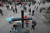 Radom, Poland, April 2, 2011:.People outside of Radom cathedral, by the monument of pope John Paul 2 on a 6-th anniversary of his death..(Photo by Piotr Malecki / Napo Images)...Radom, 2/04/2011:.Pomnik papieza Jana Pawla II pod katedra Radomiu.Fot: Piotr Malecki / Forum