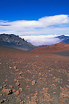 Lava field and cinder cone above a sea of clouds in Haleakala Crater, Haleakala National Park, Island of Maui, Hawaii