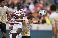 Houston, TX -  Sunday, December 11, 2016: Hunter Bandy (20) of the Wake Forest Demon Deacons heads the ball away from his goal against the Stanford Cardinal at the  NCAA Men's Soccer Finals at BBVA Compass Stadium.