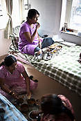 Surrogate mothers take a break for lunch at the Akanksha Infertility and IVF Clinic in Anand, Gujarat, India. The centre has become the most popular clinic for outsourcing pregnancies by western couples.
