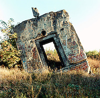 A communication bunker of the German Wehrmacht, destroyed by the Russian army shortly after 1945 and subsequently painted with graffiti by the Russian soldiers who destroyed it.  The Cold War, which formed part of the collective consciousness of post war Europe from 1945 until 1989 dominated the military and political landscape.  Often highly charged with nationalistic zeal, Soviet rhetoric and paranoia, relics of the Cold War remain as testaments to the covert era within Eastern Europe...... CHECK with MRM/FNA