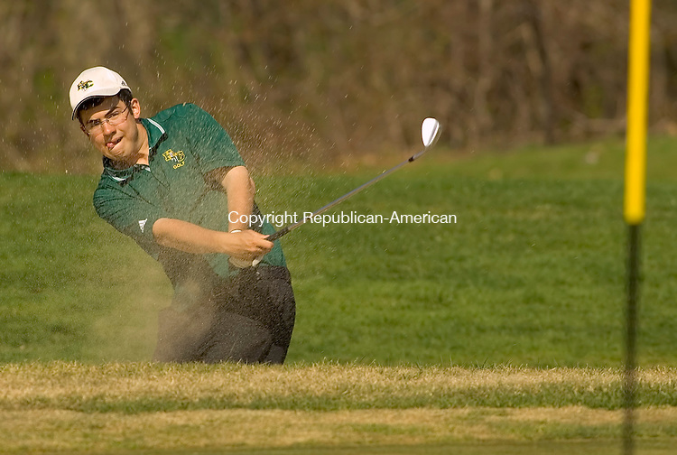 WATERBURY, CT- 24 APRIL 2008 --042408JS12--Holy Cross' Frank Lerz chips out of the sand during their meet against Wolcott Thursday at Western Hills Golf Course in Waterbury. <br /> Jim Shannon / Republican-American
