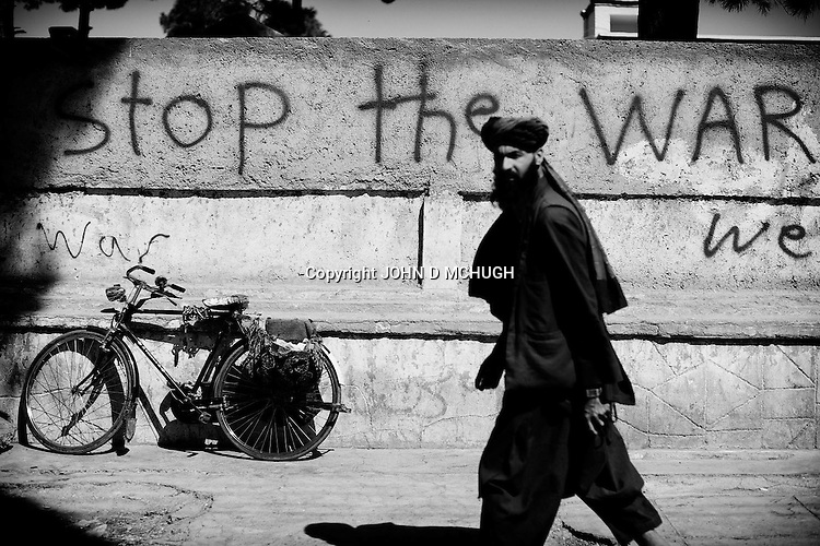 Peaceful slogans are seen on the walls of Herat, 20 September 2013. (John D McHugh)