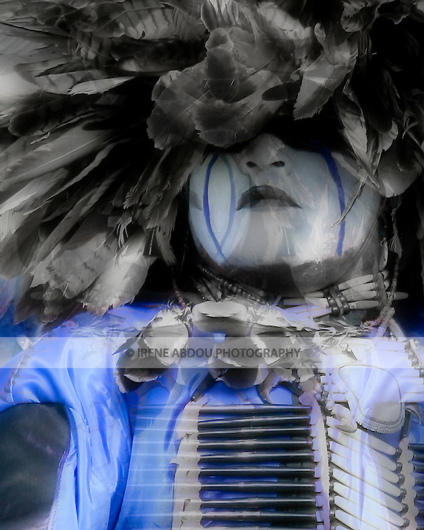 """Eagle Tail, a Native American from the Micmac Indian Tribe of Canada, dances at the 8th Annual Red Wing Native American Pow Wow in Virginia Beach, VA.  His face paint was """"gifted"""" to him by his grandfather."""