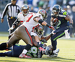 Seattle Seahawks Running back Robert Turbin  is grabbed by Tampa Bay Buccaneers linebacker Lavonte Davis, in the second quarter at CenturyLink Field in Seattle, Washington on  November 3, 2013.  The Seahawks beat the Buccaneers 27-24 in overtime. ©2013. Jim Bryant. All Rights Reserved.