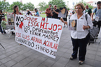 "Phoenix, Arizona - ""Where is my son"" reads this banner being held by María Guadalupe Aguilar Jáuregui (right) whose son José Luis Arana Aguilar, 34, went missing on January 2011 in the State of Jalisco, Mexico. Aguilar Jáuregui believes her son is alive. She is taking part of the The ""Caravan for Peace with Justice and Dignity"" to try to find her son. The ""Caravan for Peace with Justice and Dignity"" stopped in Phoenix on Wednesday, August 15, 2012 as it travels across the United States as a way to create awareness in the United States about the failed drug war in Mexico that has left more than 70,000 dead. The caravan is led by Mexican poet, essayist, novelist, and journalist Javier Sicilia, whose son Juan Francisco Sicilia Ortega son was brutally murdered along with six other students in Morelos, Mexico by members of a drug cartel on March 28, 2011. In response, Sicilia created the Movement for Peace with Justice and Dignity --popularly known as ¡Ya Estamos Hasta la Madre! or We Have Had It!-- calling for an end the drug cartels bloodshed. Photo by Eduardo Barraza  © 2012"